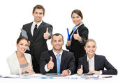 Group of thumbing up managers — Stock Photo