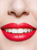 Close up of female smiling red lips — Stock Photo