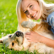 Close up of girl who strokes retriever — Stock Photo