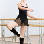 Постер, плакат: Ballerina dancing near barre in dancing hall
