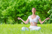 Woman in lotus position zen gesturing — Stock Photo