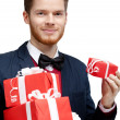 Man with a lot of presents — Stock Photo