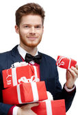 Man with a lot of presents — Stockfoto