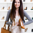 Woman can't choose stylish shoes — Stock Photo