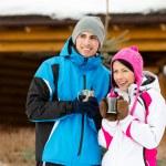 Couple drinks tea outdoors — Stock Photo #33334909