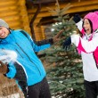 Cute couple playing at snowballs and having fun — Stock Photo #33335189