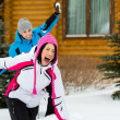 Couple having fun when having snowball fight — Stock fotografie