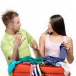 Couple packs suitcase — Stock Photo