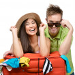 Couple packs up suitcase for traveling — Stock Photo