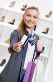 Woman showing credit card — Stock Photo