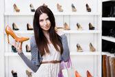 Woman keeping stylish pump — Stock Photo