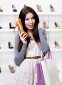Woman handing shoe — Stock Photo