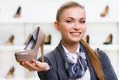 Woman keeping shoe — Stock Photo