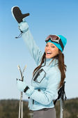 Female alps skier thumbing up — Stock Photo