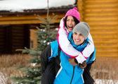 Couple having fun during winter holidays — Stock Photo