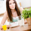 Girl with healthy cereals and orange juice — Stock Photo