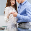 Young man presents engagement ring to his girl — Stock Photo #33812347