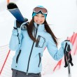 Stock Photo: Half-length portrait of womhanding skis