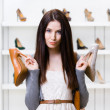 Woman can't choose heeled shoes — Stock Photo #33815069