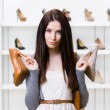 Woman can't choose heeled shoes — Stock Photo