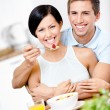 Male feeds and embraces his girlfriend — Stock Photo