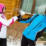 Young couple playing at snowballs and having fun — Stock Photo
