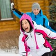 Couple having snowball fight — Stock Photo
