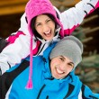 Happy couple having fun during winter vacations — Stock Photo