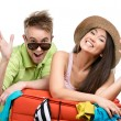 Couple packs up suitcase for travel — Stock Photo #33819183