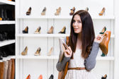Girl can't choose stylish pumps — Stock Photo