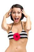 Woman wearing bikini with red flower — Stock Photo