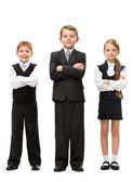 Full length of little children with hands crossed — Stock Photo