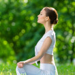 Profile of sportive woman in asana position zen gesturing — Stock Photo