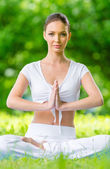 Woman in lotus position prayer gesturing — Stock Photo