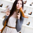 Woman can't choose footwear — Stock Photo