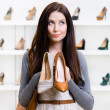 Girl can't choose footwear — Stock Photo
