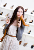 Woman can't choose footwear — Stockfoto
