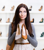 Girl can't choose footwear — Foto de Stock