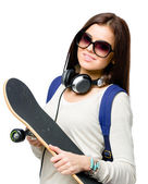 Portrait of teenager with skateboard — Stock Photo