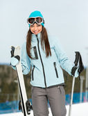 Half-length portrait of woman mountain skier — Stock Photo
