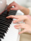 Close up shot of hands playing piano — Stock Photo