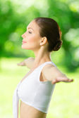 Profile of woman with outstretched arms — Stock Photo