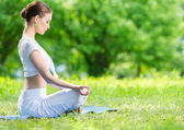 Profile of woman in lotus position zen gesturing — Stock Photo