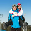 Stock Photo: Happy couple of skiers have fun