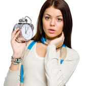 Amazed young girl with alarm clock — Stock Photo