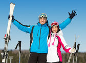 Half-length portrait of embracing downhill skiers — Stock Photo