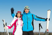 Half-length portrait of hugging skiers — Stock Photo