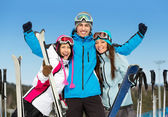 Group of skier friends with hands up — Stock Photo