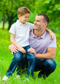 Father keeps son on the knee — Stock Photo