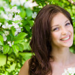 Young woman near the flowered tree — Stock Photo #36133299